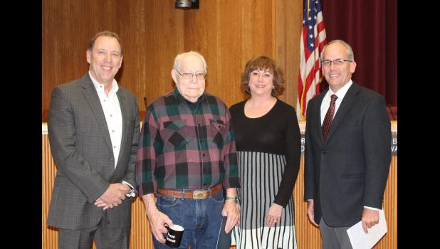 John Kuchenbecker was honored as WWII Veteran of the Month by the Rapid City Council. From left, Brett Estes, council member, John Kuchenbecker, Darla Drew, council member, and Mayor Steve Allender.