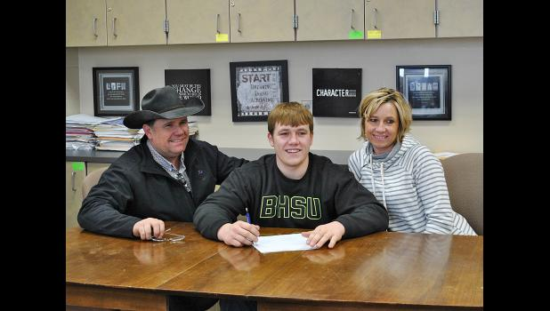 Cass Lytle, a senior at Wall High School, recently signed a letter of intent to play football for Black Hills State University.