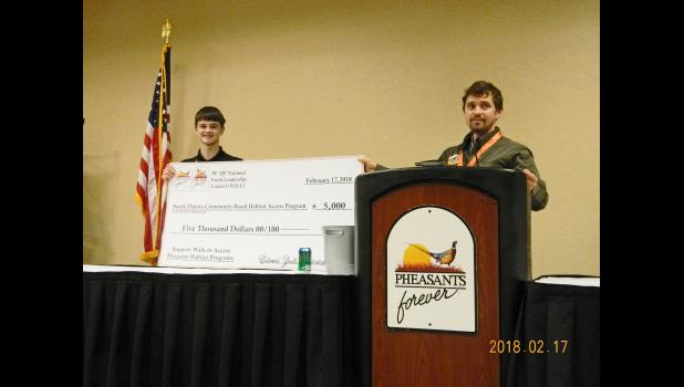 Birkeland issues a $5,000 check to Aberdeen Pheasant Coalition