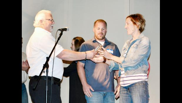 Kelly Miller, Black Hills Community Economic Development president, presented the organization's Small Business Startup of the Year award to Colton and Erin Fitzgerald, owners/operators of Philip Hardware.
