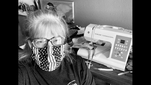 Deb Smith volunteered her time as well to make masks. This one is very patriotic.