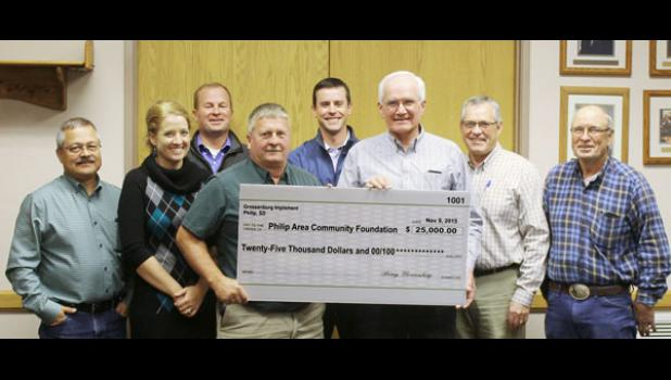 Members of the Philip Area Community Foundation in attendance at the presentation of the $5,000 per year donation from Grossenburg Implement included, back row from left, D.J. Rush and Dillon Kjerstad, Front: Ray Smith, Britni Ross, Joe Woitte – Grossenburg site manager, Roger Porch, Gerry Rislov and Marion Matt.