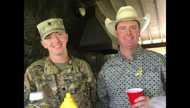 Parker Peterson and Paul (dad) Peterson at family gathering following the deployment ceremony in Rapid City.  Photo courtesy Joey Peterson