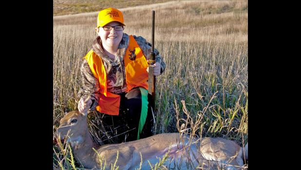 A proud young hunter shown with her harvested deer from the 2016 South Dakota Game Fish and Park Youth Hunt and Camp.
