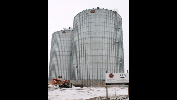 The shells of these two new grain bins will eventually be connected by a leg reaching 203 feet up, which will feed the bins with product unloaded from grain trucks. The two bins will also be connected to the pre-existing structures by an overhead conveyor system so their grain can be loaded into train cars.