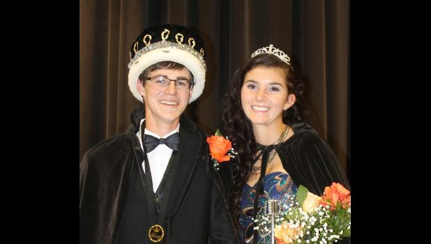 "The Philip High School coronation, Tuesday, Sept. 13, saw Kreid Amiotte crowned king and Peyton Kuchenbecker crowned queen. Kuchenbecker's first duties were to bless the school's cross country shoes, football and volleyball. Outside, Amiotte lit the Philip Scotties' huge ""P."""