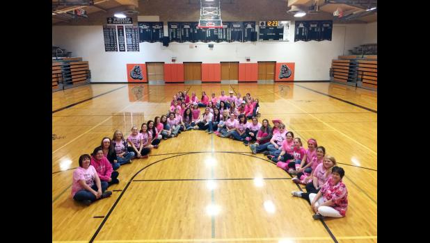 ​Some of the women – faculty and students – of Philip High School created a human pink ribbon (cancer awareness) in recognition of Dig Pink Week.