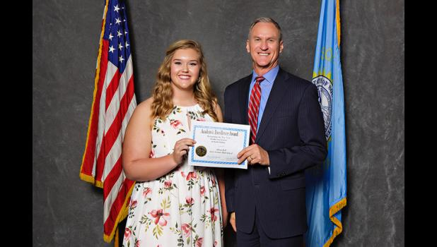 Jones County High School senior and valedictorian Aliana Kell received an award for her academic accomplishments at the Academic Excellence Banquet in Pierre on Monday, April 24. Congratulations and well done, Aliana! Pictured above is Kell with South Dakota Governor Dennis Daugaard.