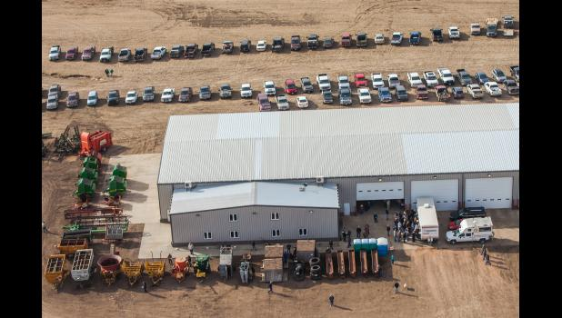 Rows of farm machinery and vehicles surrounded the Dowling shop. Cars lined the dirt roads from the shop leading all the way to Draper.