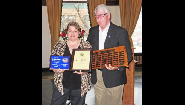 Jo Manke-Rodgers receives Postmaster of the Year Award presented by Steve Lenoir, theVice President of South Dakota's National League of Postmasters.