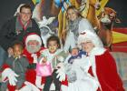 ​The Brit Miller family took the opportunity to pose with Santa and Mrs. Claus.