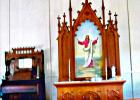 The original altar and piano inside of Immanuel Lutheran church.