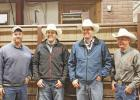Scott Vance, far left, and his dad, Gary Vance, far right, announced the sale of Faith Livestock Commission Co. at Monday's sale, May 15. The next generation to operate the sale barn is Mason Dietterle, middle left, and Dace Harper, middle right, both of the Faith area.